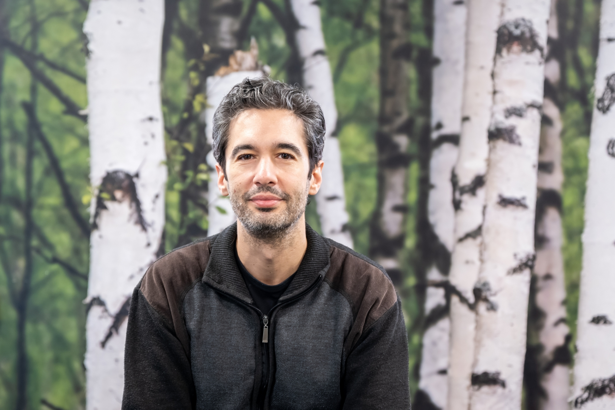 Felipe Cava with a birch tree background